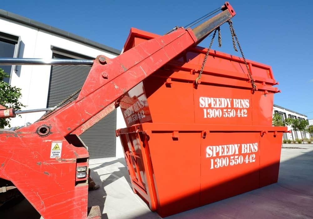 Skip bin being loaded at Speedy Bins truck for Sunshine Coast skip bins for hire order